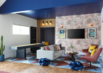 Clubhouse Area With a Couch and TV at The Rowan Apartments