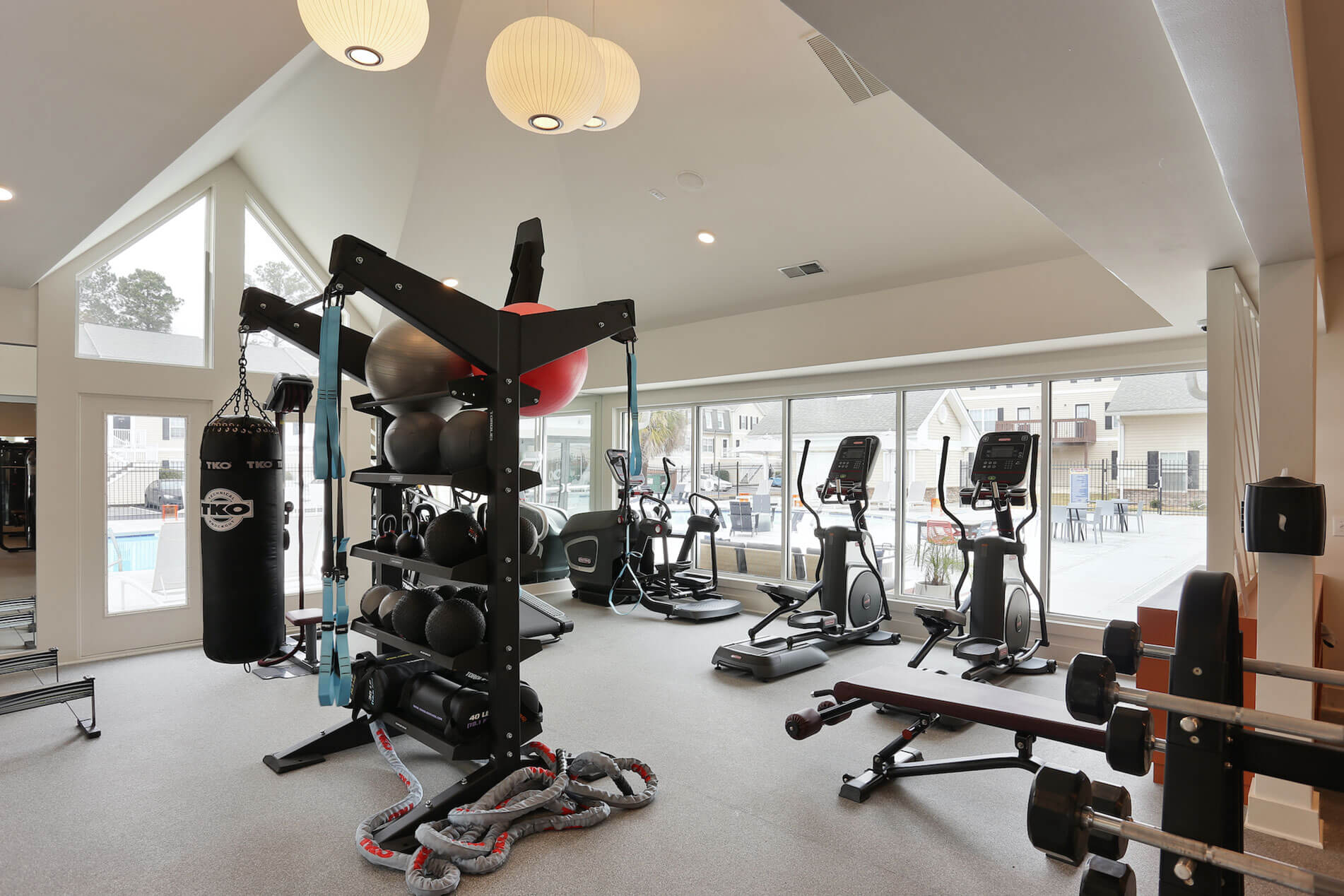 Gym with Exercise Equipment at The Rowan Apartments