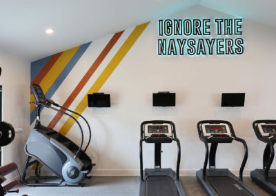 Gym with Treadmills in the Background at The Rowan Apartments
