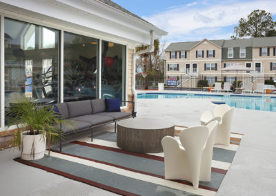 Outdoor Pool Lounge Area With a Table and Chairs