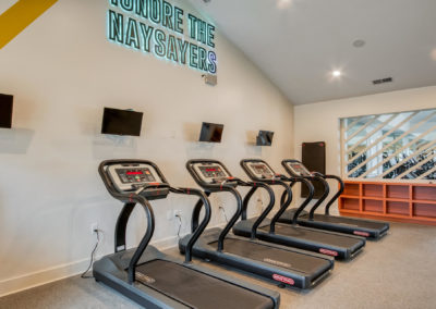 Four Treadmills in the Exercise Room at The Rowan Apartments Near USC Columbia