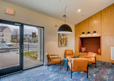 Waiting Area With Four Chairs at The Rowan Apartments